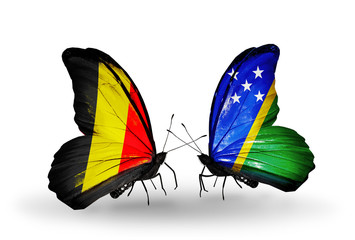 Two butterflies with flags Belgium and Solomon Islands