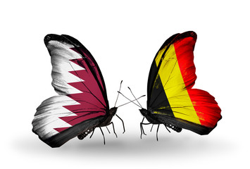 Two butterflies with flags Qatar and Belgium