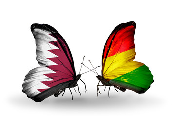 Two butterflies with flags Qatar and Bolivia