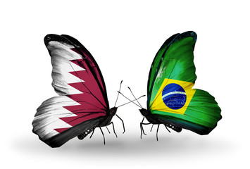 Two butterflies with flags Qatar and Brazil