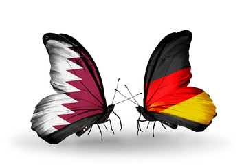 Two butterflies with flags Qatar and Germany