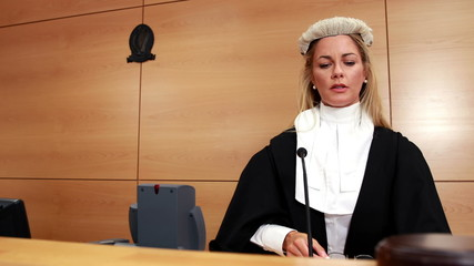 Judge speaking while banging gavel on sounding block