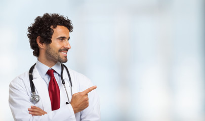 Smiling doctor pointing his finger