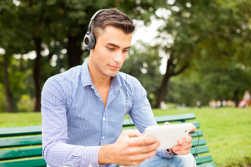 Man listening music in a park
