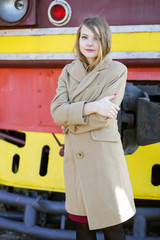 Woman in beige coat at cold day