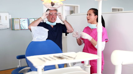 Happy dentist chatting with nurse
