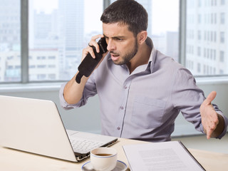 businessman at business district office upset on phone