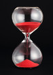 Hourglass with red sand running through the bulbs - 75939058