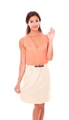Pretty brunette lady in elegant skirt greeting you