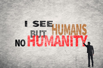 text on wall, I See Humans But No Humanity
