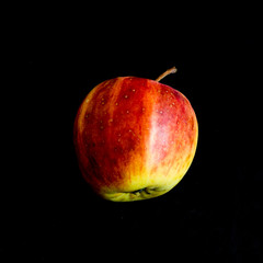 Red apple on black background