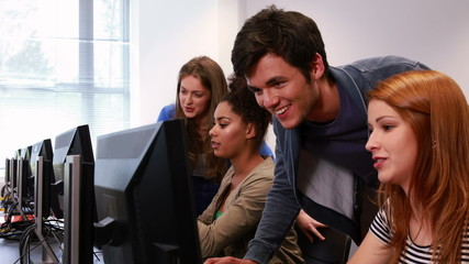 Students working together in computer room