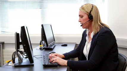 Call center agent working at desk
