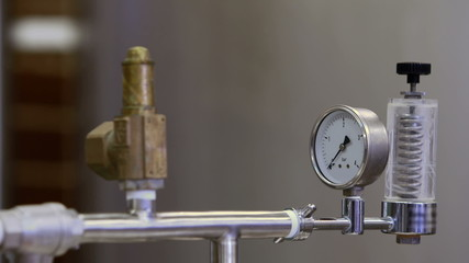 Focus on taps and gauge on vat