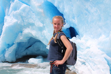 Young woman on the Nigardsbreen, glacier in Norway.