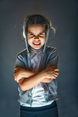 scary girl child on Halloween face terrifies image of evil and t