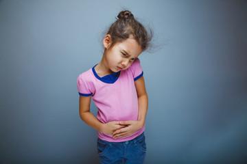 Teen girl child abdominal pain on gray background