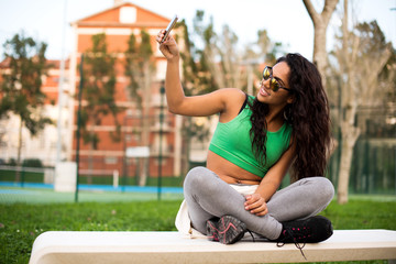 Woman taking selfies