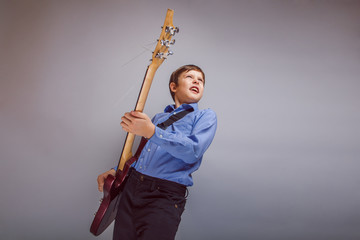 teenager a boy brown European appearance playing guitar
