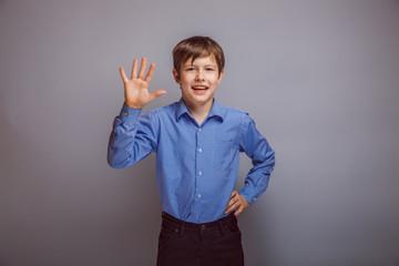teenager boy brown hair of European appearance waving experienci