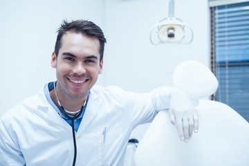 Portrait of smiling male dentist