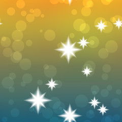 Seamless starry bokeh background in blue and yellow