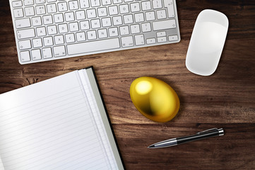 gold egg on desk