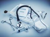 Medical instruments for ENT doctor on pale blue