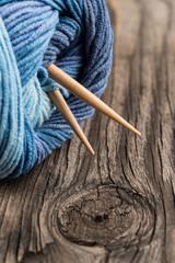 Natural woolen yarn knitting vintage wooden background