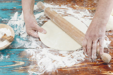 Woman kneading, baking cookies, pizza or bread