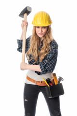 Handwerker schlägt mit Vorschlaghammer