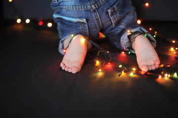 feet of the kid got confused in a garland
