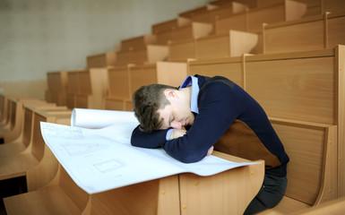 the student fell asleep behind a school desk