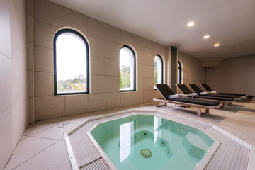 Beds and jacuzzi in luxury health spa