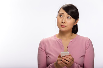 Young Asian woman texting message on cellphone