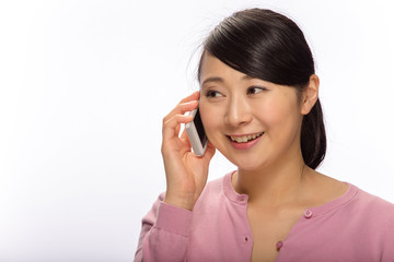 Young Asian woman talking on cellphone