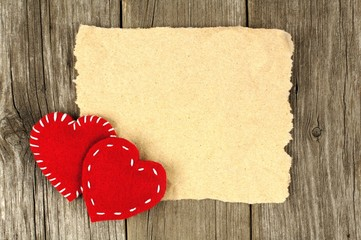 Valentines Day hearts with blank card on old wood