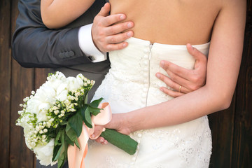 Married couple embraced, detail of the bust and arms