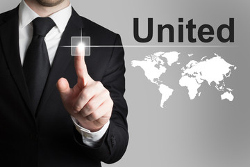 businessman pushing button united world