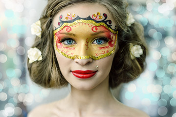 Young woman in a carnival mask
