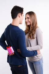 cheerful young couple giving gifts for valentine day