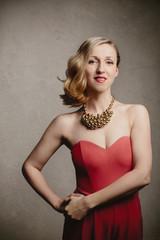 Elegant blond woman in evening wear