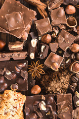 Pieces of chocolate, cookies and nuts