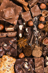 Pieces of chocolate, cookies, nuts