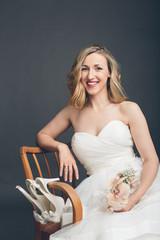 Glamorous bride displaying her bridal shoes