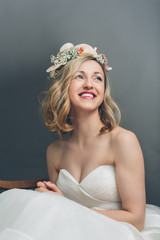 Pretty blond bride smiling with happiness