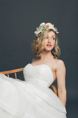 Relaxed young bride reclining in a chair