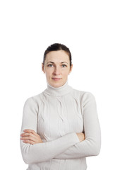 portrait of a woman wearing white sweater posing with arms acros