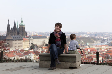 Mother with son on St. Vitus Cathedral background