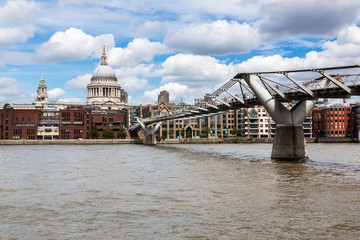 LONDON - AUGUST 3: St Paul's Cathedral and Millennium Bridge on